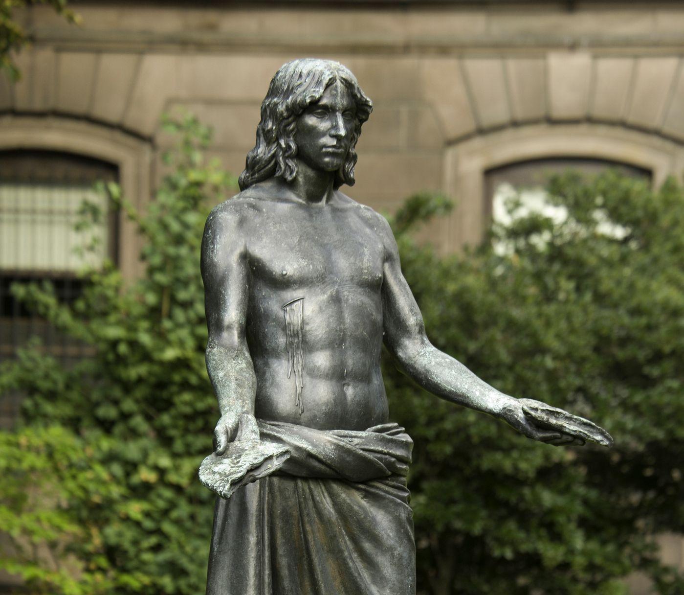 jesus-breaking-bread-statue-secret-world